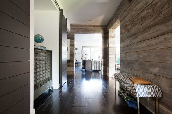 You'll Envy This Effortlessly Cool Family Home // Upholstered bench, wood walls, cabinet on wheels: