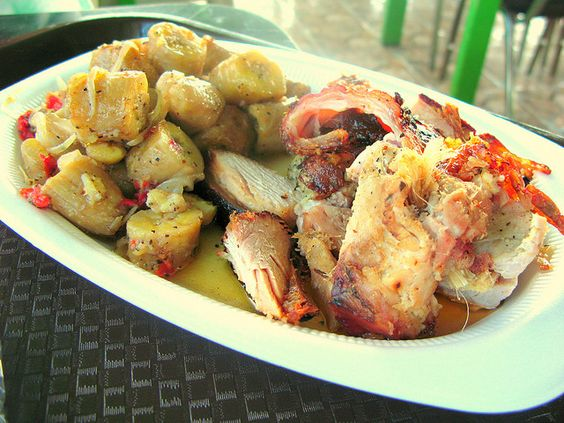 """Guavate"". This dish consist of roast pork with diced boiled bananas!!       Lechón asado con Escabeche de Plátano"
