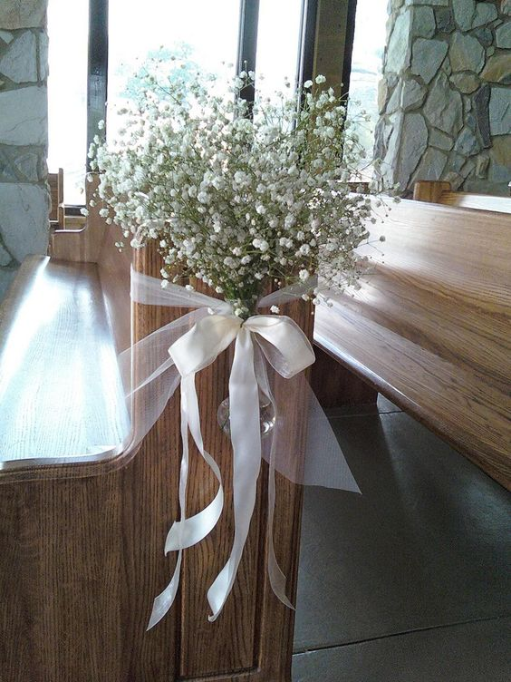 Perfect! We can tie the mason jars up to the church pew with ribbon!