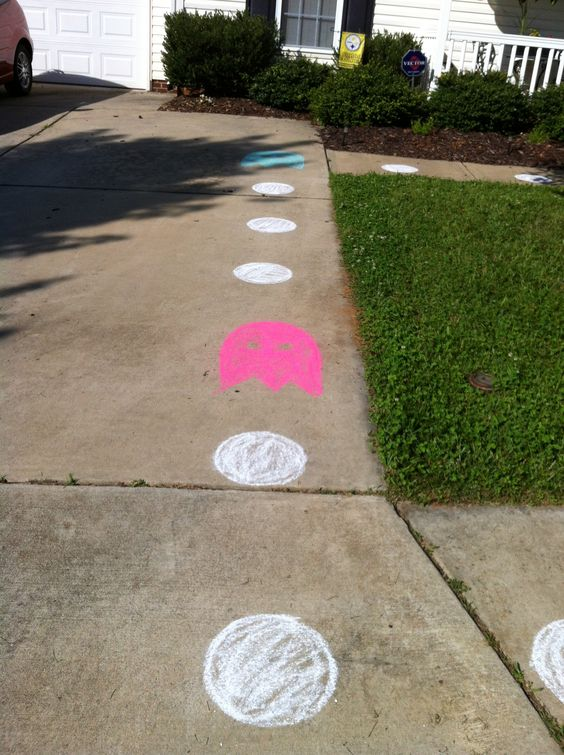 outside decor DYI- sidewalk chalk. Took no time at all to trace a bowl for the circle and free hand the ghost on the sidewalk and walk way to the front door to draw guests into the theme even before entering.