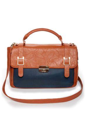 navy and tan handbags