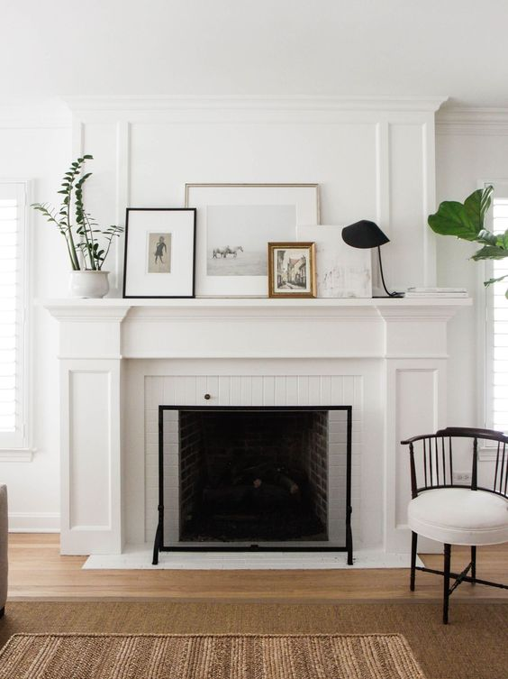 Try leaning framed photographs with some fresh greenery on the fireplace mantel for a simple, spring-ready look!: