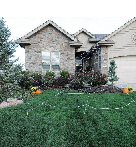 giant spider yard decorations and spider webs on pinterest. Black Bedroom Furniture Sets. Home Design Ideas