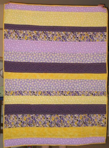 yellow and purple quilt.., like this but it'd be  just yellow or yellow and brown...