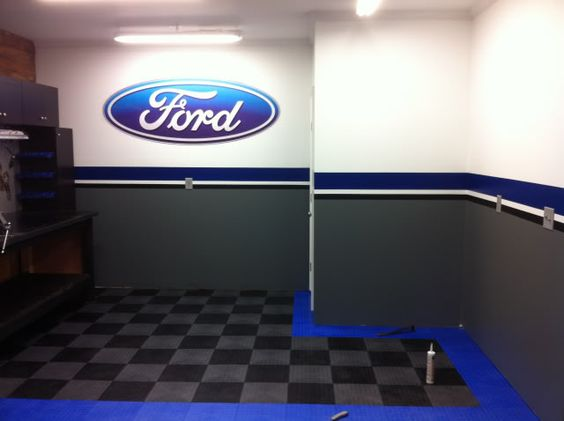 Ford themed garage the ford oval on the wall is a decal for Garage ford a lyon