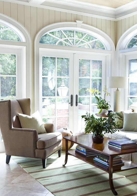Classic Living Room With Traditional Furnishings And Gorgeous Arched Windows