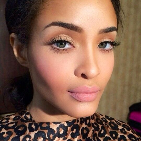 Baby pink lips and blusher with wispy eyelashes create a feminine and youthful look.: