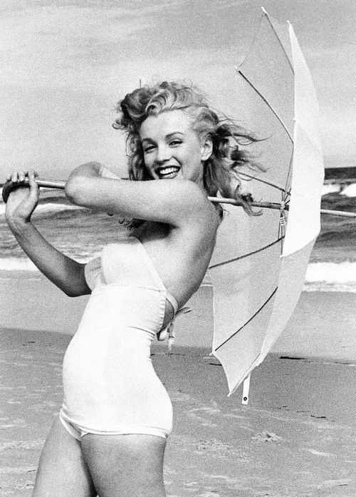 """1949. Marilyn at Tobey Beach - Long Island . Photo session with umbrellas. """"White umbrella"""". Photo by Andre de Dienes."""