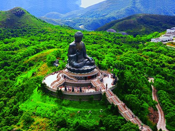 Climb the 268 steps to Tian Tan Buddha on Lantau Island, Hong Kong.