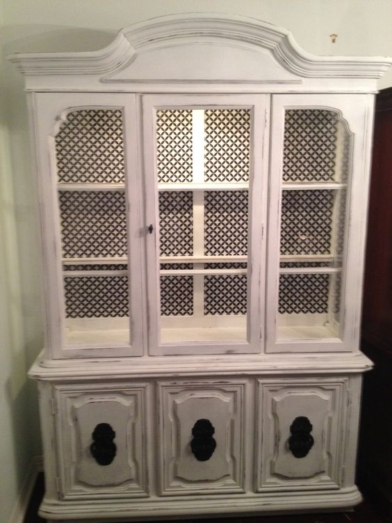 This china cabinet was tired looking until a young couple from 'The Courtyard' estate sale in Austin gave it new life.  Now it's gorgeous!