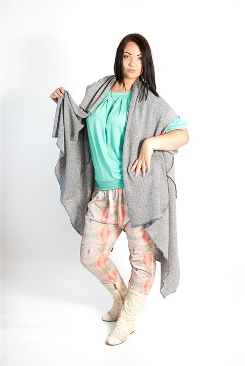 Grey woollen cardigan features in front light drapes, short sleeves and beautified with contrasting color seams. The cardigan may be turned upside down and you will get a shorter with more front drapes cardigan.