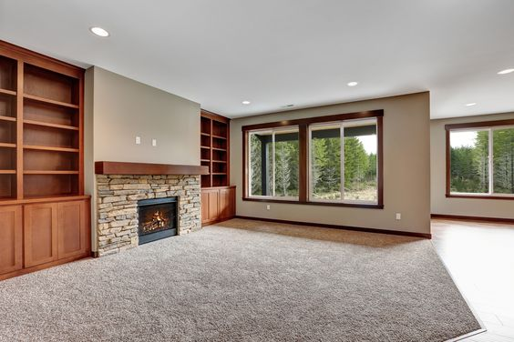 Stone fireplace surround, hemlock mantle and built in bookshelves.