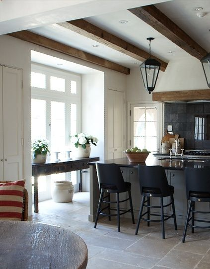 Love the wooden beams with the black chairs and counter top.