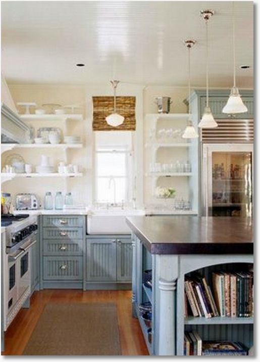 I love the open shelving for easy access to large pieces, the glass front fridge, schoolhouse lighting, great stove, and the built-in space for cookbooks in the kitchen -where one will actually USE them. Brilliant!