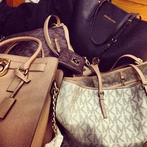 #MKBags  OMG !  I'm so in love!  And some of them just cost $32.99.It never happened. #MichaelKors