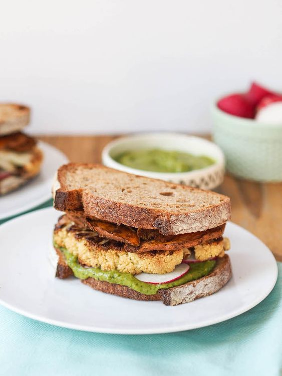 Roasted Cauliflower Sandwich with Spicy Sweet Potato Chips and Cilantro Avocado Sauce