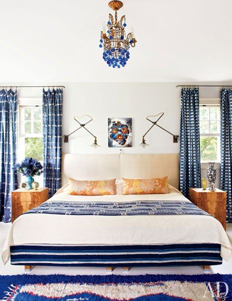 An East Hampton master bedroom features a palette of bold blues