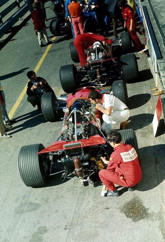 Graham Hill & Jochen Rindt in their Gold Leaf Lotus-Ford 49B's in the pits at Zandvoort, 1969 Dutch Grand Prix