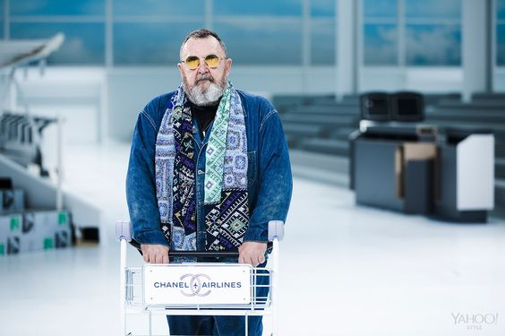 Michel Gaubert the day before the Chanel show with one of the luggage cart props. Photography by Cyrille George Jerusalmi for Yahoo Style.