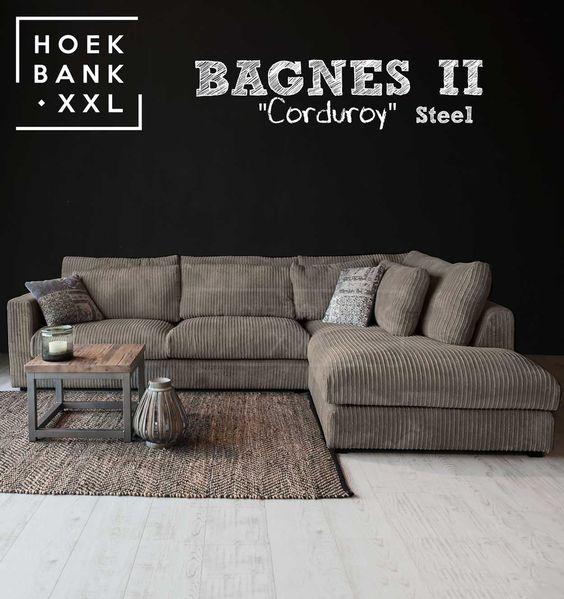 Hoekbank Bagnes II in de kleur grijs  Het is een grote moderne hoekbank met losse kussens en een