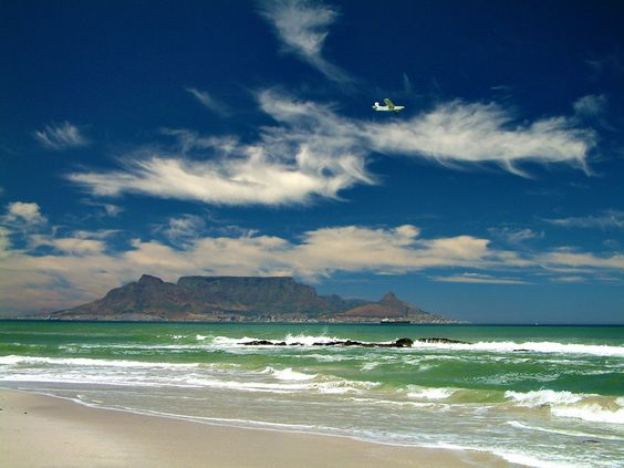 Table Mountain from across the waters at Bloubergstrand, near Cape Town, South Africa.