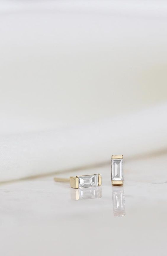 When the natural light catches the delicate, yet structured diamonds of the Baguette Earrings just right | Vrai & Oro