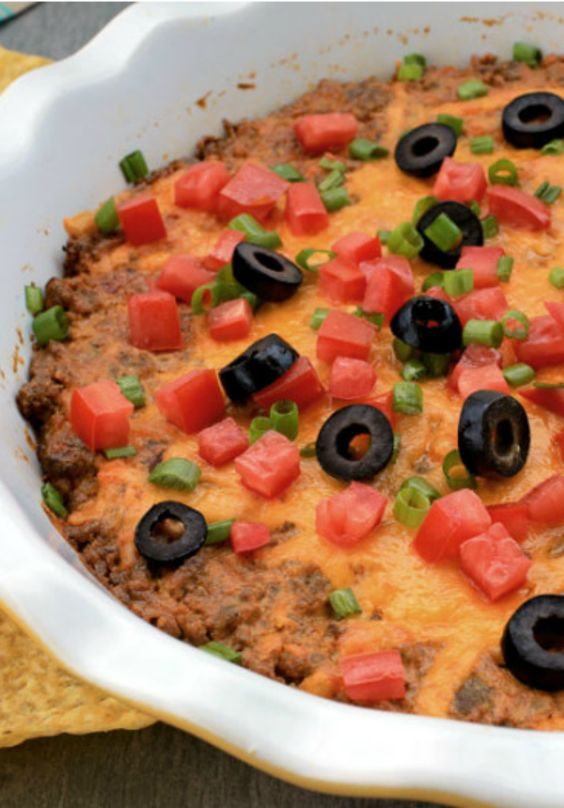 Serve this cheesy taco dip as a delicious game day snack! Make it ahead and pop it in the oven to bake just before your guests arrive.