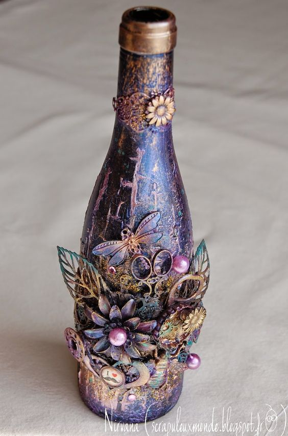 One of the first altered bottles we are making these will for How to decorate empty glass jars