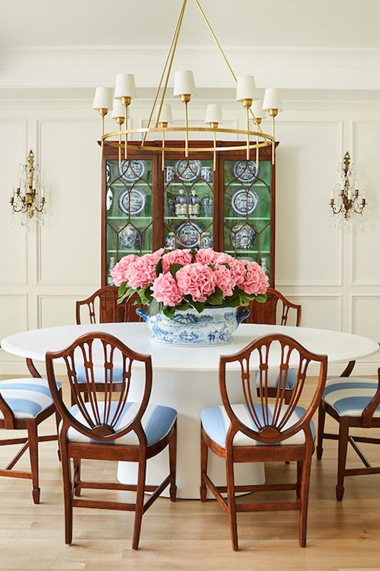 A Formal Dining Room. Beautiful Flower arrangement. Classic Dining area.