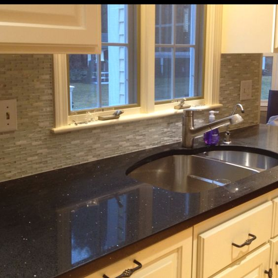 Sparkling black quartz counter with glass backsplash. So inlove with this counter!!!