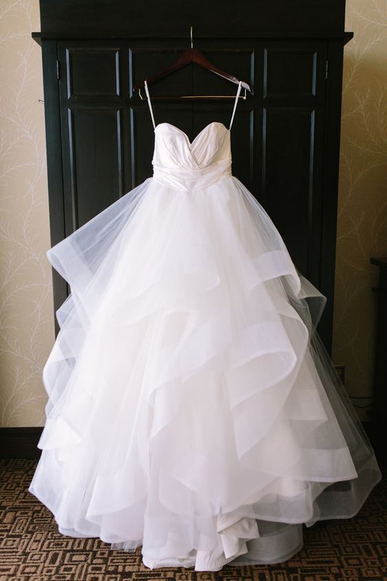 layered wedding dress - photo by The Compass Points Here http://ruffledblog.com/ethereal-chapel-wedding