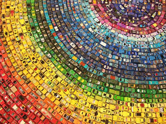 Artist David T. Waller used 2,500 old toy cars to create Toy Atlas Rainbow, a beautiful installation that won the People's Award at the Arts Depot Open in 2010. The cars in the installation are arranged in a circular pattern according to their color, making a beautiful rainbow out of Hot Wheels cars. (j)