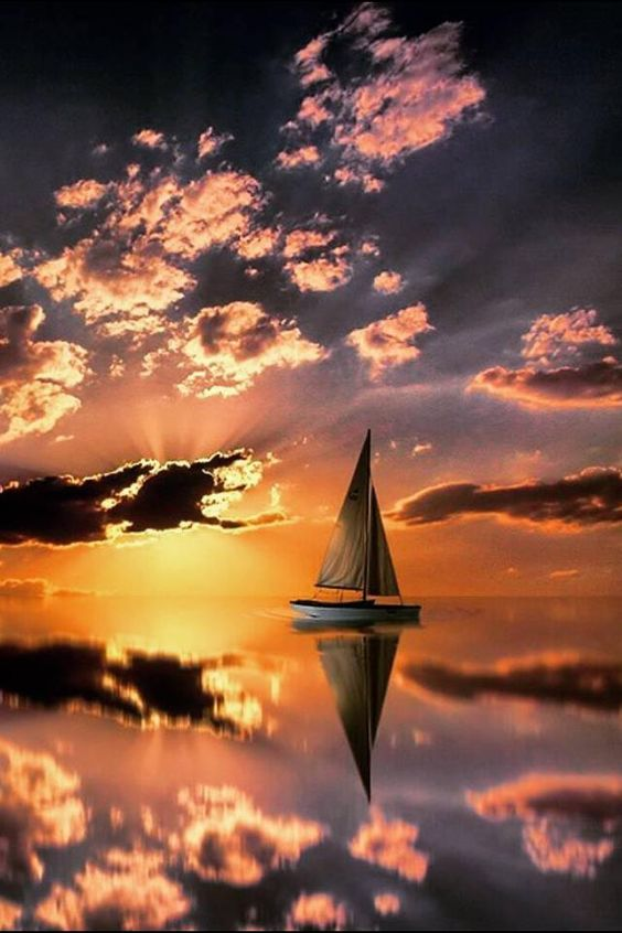 Mmm... A serene sailboat glides away into the sunset on a still sea... Nature's beauty
