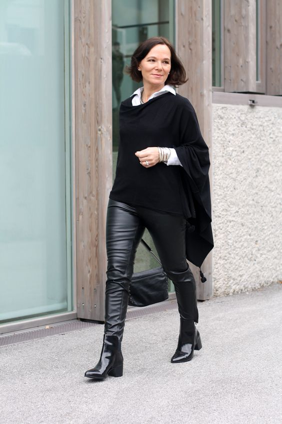 All black in leather leggings and a poncho | Lady of Style