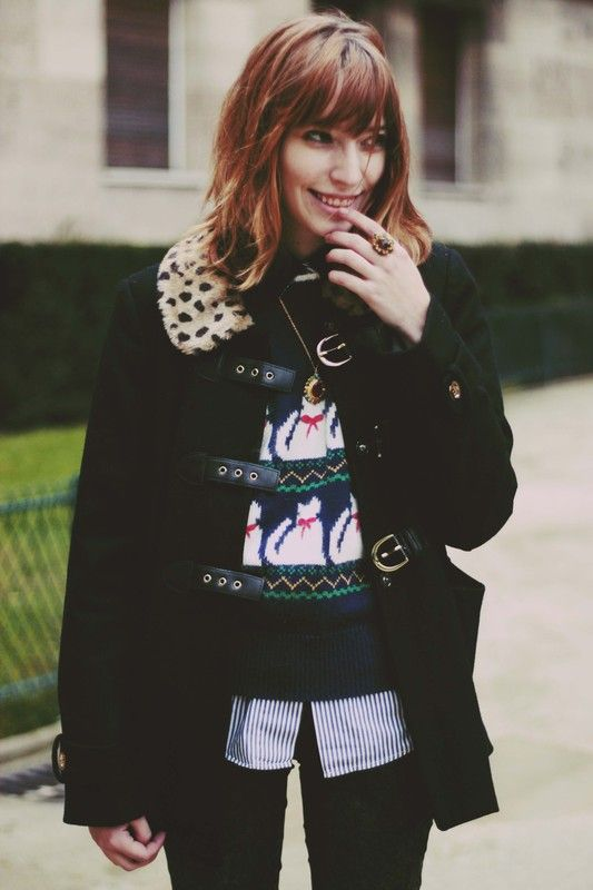 buckled jacket and a silly cat sweater, yes