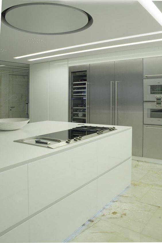 Cucina corian design bianco illuminazione led acciaio cappa incasso circolare - Cucine gaggenau ...