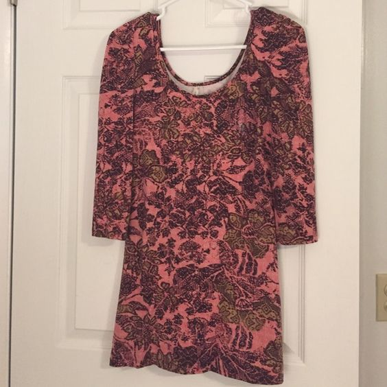Free people floral tunic Free people size small, pink tunic with floral print, gently worn Free People Tops Tunics