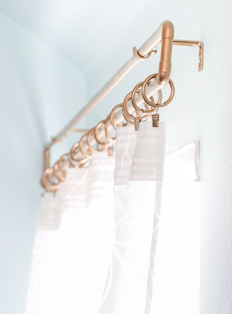 Use copper pipe from the hardware store along with gold spray paint to create this uniquely shaped rectangle pipe curtain rod. It is glam gold home decor at its best.