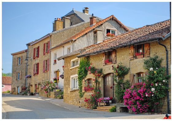 Street in Torgny, Belgium (province Luxembourg). Houses and homes decorated with flowers. Nicest Streets in the World.