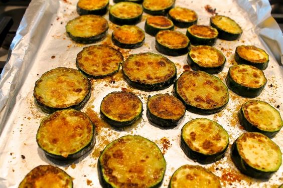 Roasted Parmesan Zucchini Bites-      zucchini, sliced into 1/2-inch-thick rounds or slices     Parmesan cheese, freshly grated     olive oil