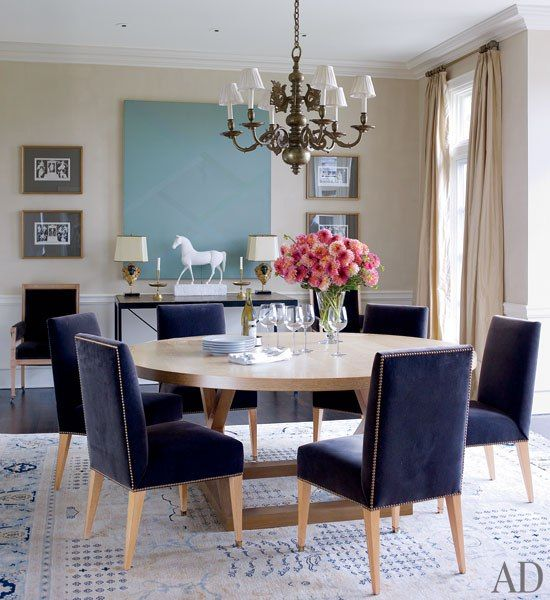 Neutral walls are the perfect background for these stunning navy blue chairs.