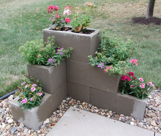 Cement Block Planter. Would be cute to do this where my railing ends on the front porch!!!! :)