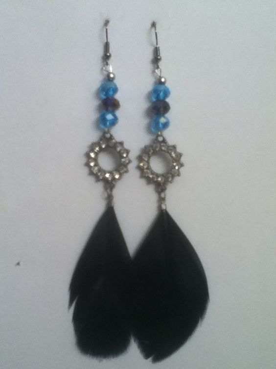 blue crystals with circle diamonds with a black feather at the bottom