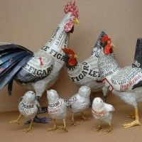 papier mache poultry. I love how they left some of the newsprint revealed.