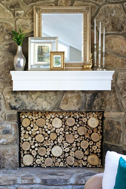 Faux stacked log fireplace tutorial livelovediy diy for Artificial logs for decoration