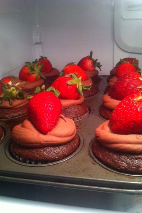 Chocolate covered strawberry cupcakes with a strawberry purée filling... What I do when bored lol delicious though!