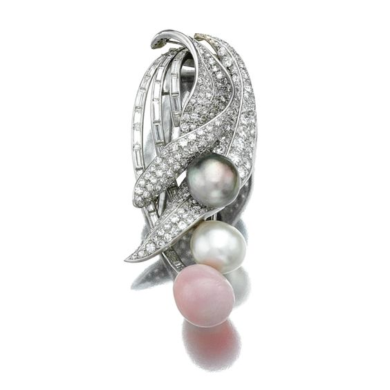 CONCH PEARL, PEARL AND DIAMOND BROOCH Set with a conch pearl and two pearl drops, suspended from a stylised leaf motif set with baguette, single-, circular- and brilliant-cut diamonds, mounted in platinum.