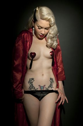 Sexy tattoo at right place btw mic nipples cups.