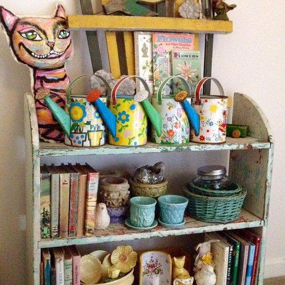 ...labor day weekend...time to clear the shelves and put out some pumpkins...fool ourselves into believing that autumn has arrived... #vintagewateringcan #vintageplanter #crazycat