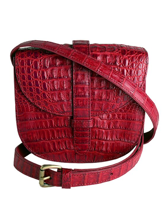 ZINK... Our NEW Mini-Gypsy Bag in Red Crocodile... Lined in calfskin. Part of the proceeds from the sale of this bag goes to: http://www.safeplace.org/  ZINK in Austin at 11 Jefferson Square 1601 West 38th Street or online at http://www.zinkcollection.com/mini-gypsy-crossbody-red-crocodile/  The ZINK 2013 Holiday Red Mini-Gypsy Bag. People have a heart for ZINK and ZINK has a heart for people so $200 from each sale will go to SafePlace in Austin, Texas.